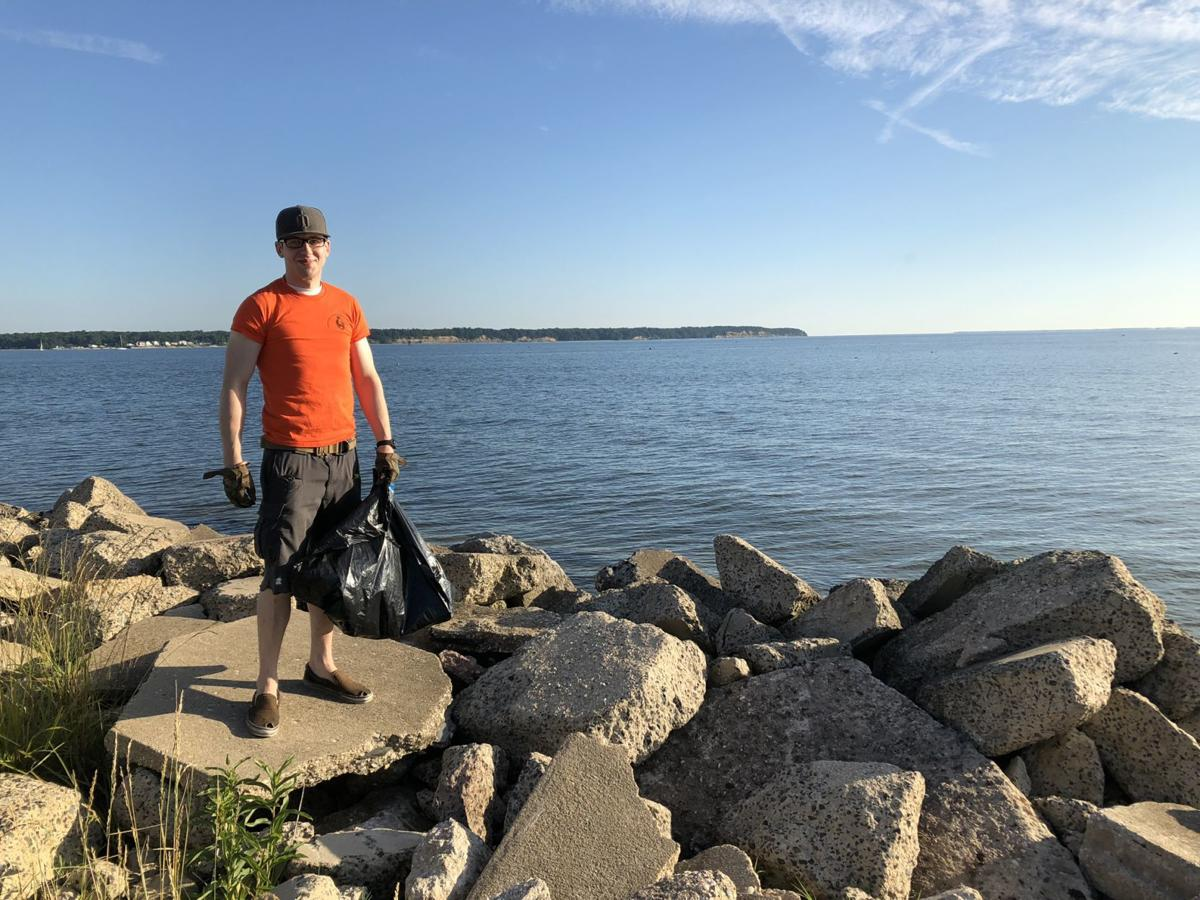 Pax volunteers pick up after others during Clean the Bay Day
