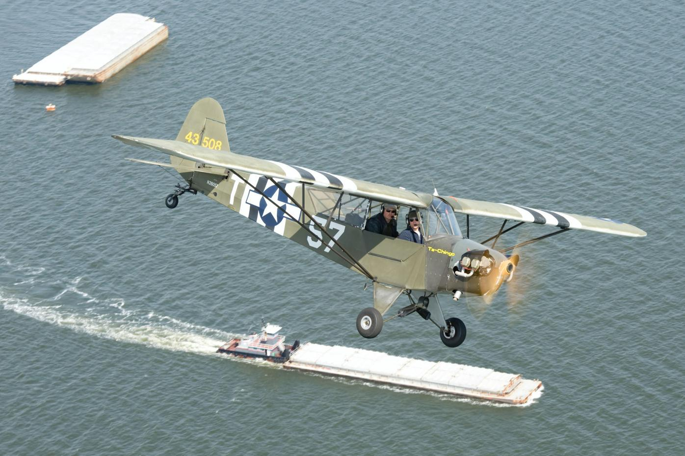 Test Pilot School XO participating in WWII anniversary flyover