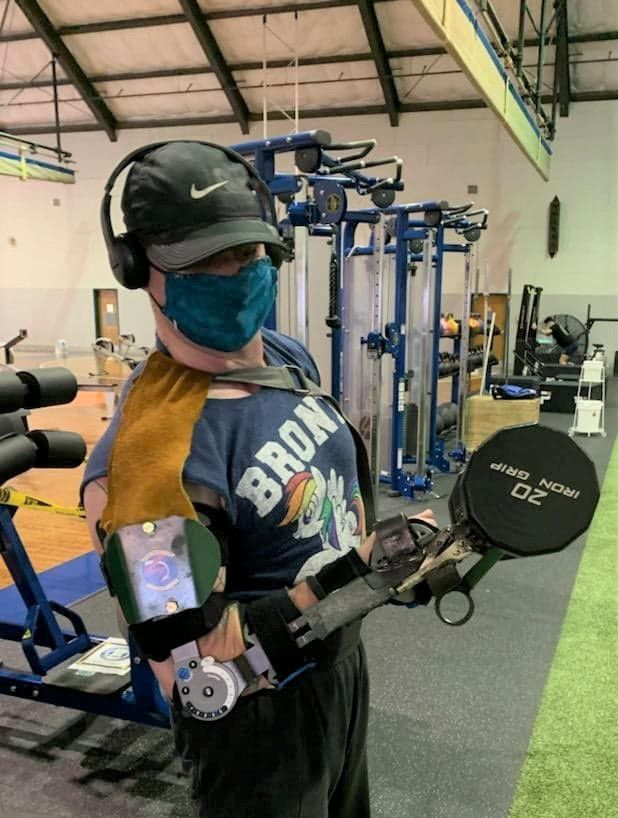 Sailor designs, builds prosthetic device to help with weightlifting