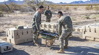 Marines look at tactical resupply UAS during field assessment