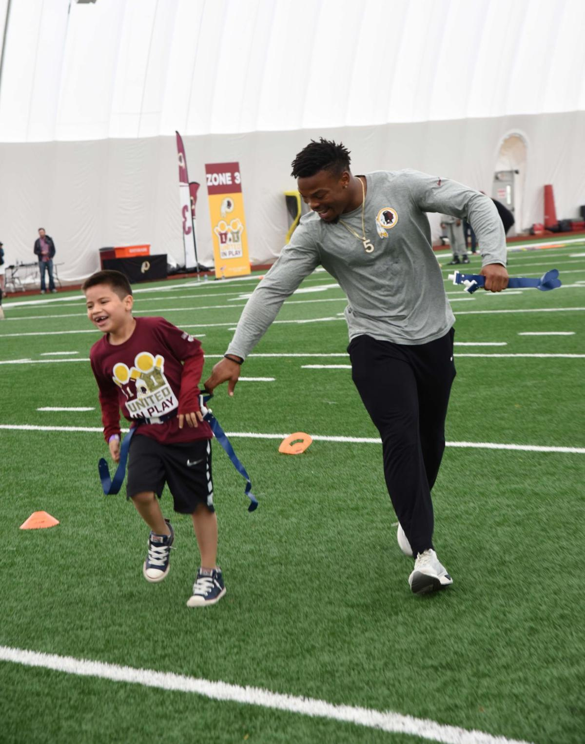 Kids of Fallen Service Members, ÔUnited in PlayÕ with Washington Redskins Charitable Foundation and Yellow Ribbons United for fun Armed Forces Day
