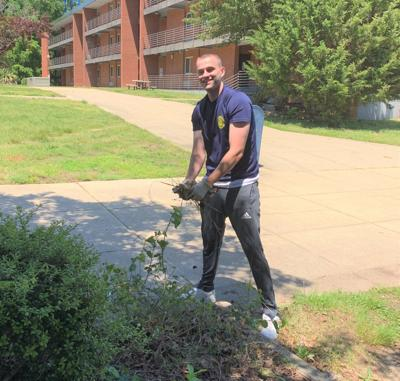 Sailor cleans up barracks grounds during time off