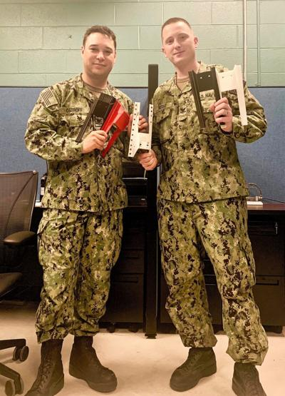 Two Sailors work with iHub team to solve squadron request