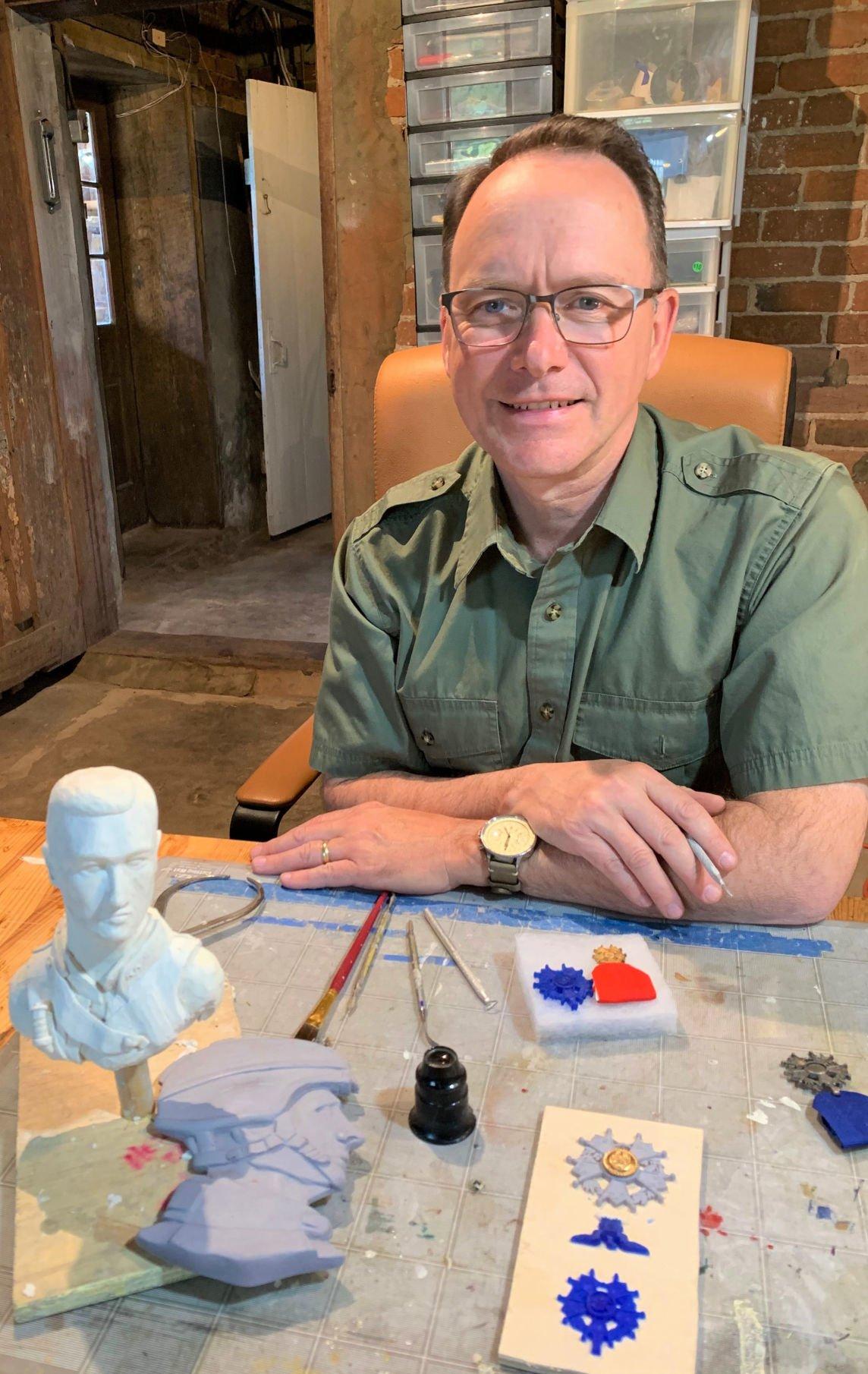 Joe Winslow with sculptures