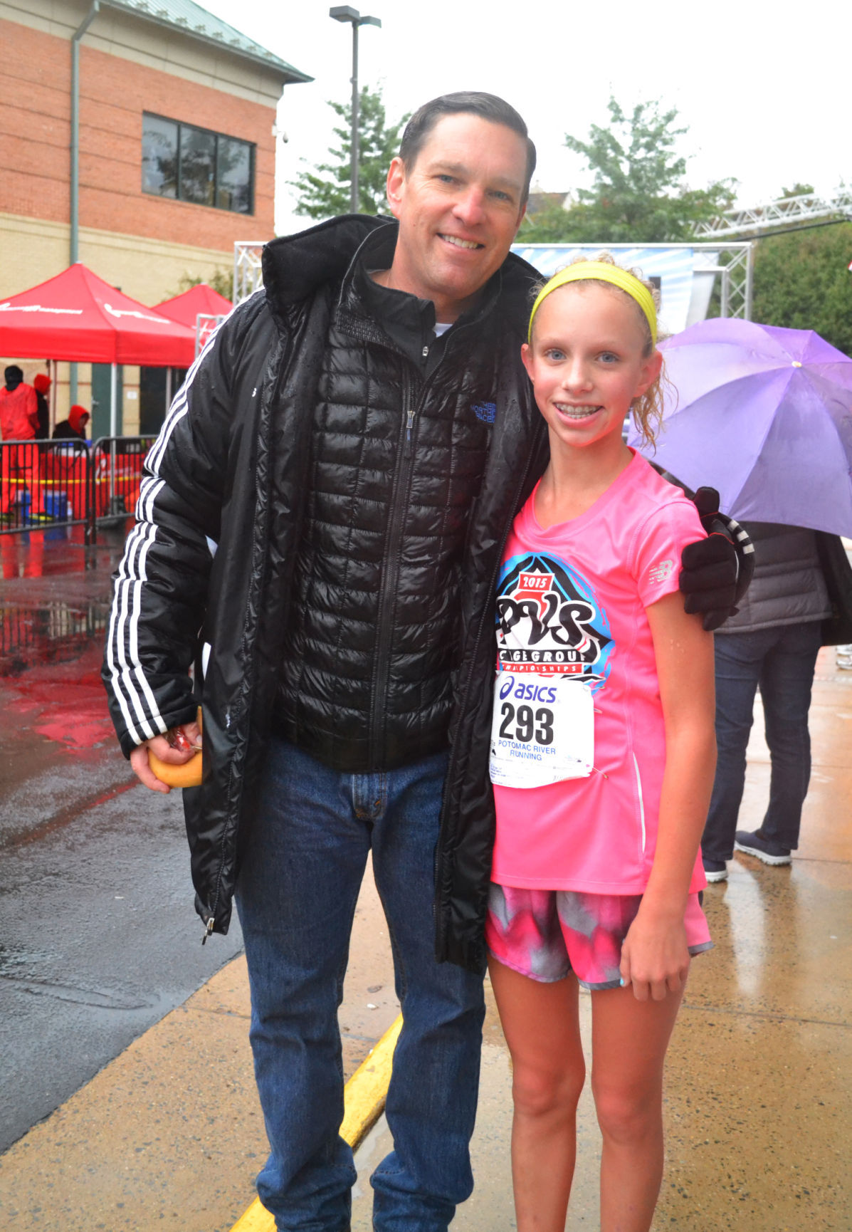 Participants Take On Downpours To Run With The Warriors