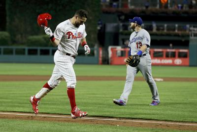 Walk-off homer in 16th is Plouffe positive Phillies are resourceful