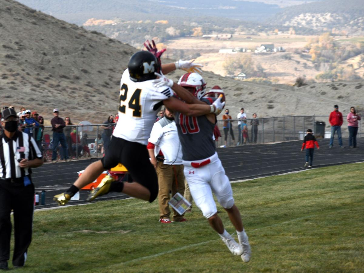 Micah Defield (10) breaks up pass to Colby Clatterbaugh
