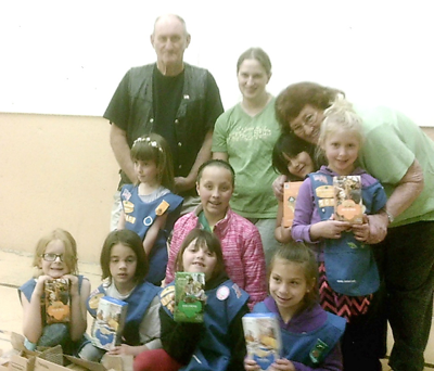 Girl Scouts donate cookies to troops