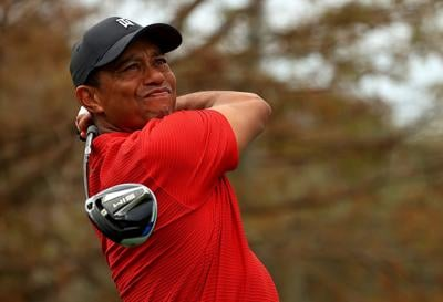 ORLANDO, FLORIDA- DECEMBER 20: Tiger Woods of the United States hits his tee shot on the 15th hole during the final round of the PNC Championship at the Ritz Carlton Golf Club on December 20, 2020 in Orlando, Florida.