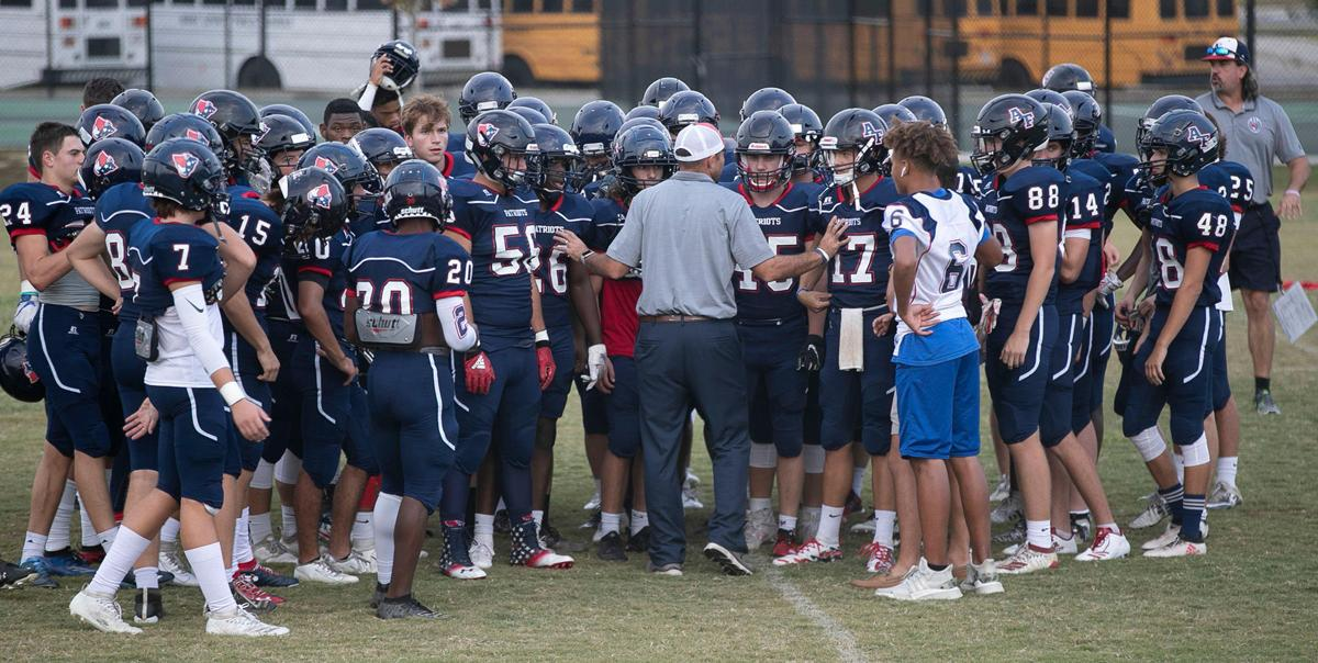Apex Friendship coach Adam Sanders talks with his players prior to the conclusion of their game against Middle Creek on Monday, Sept. 30, 2019 in Apex, N.C.
