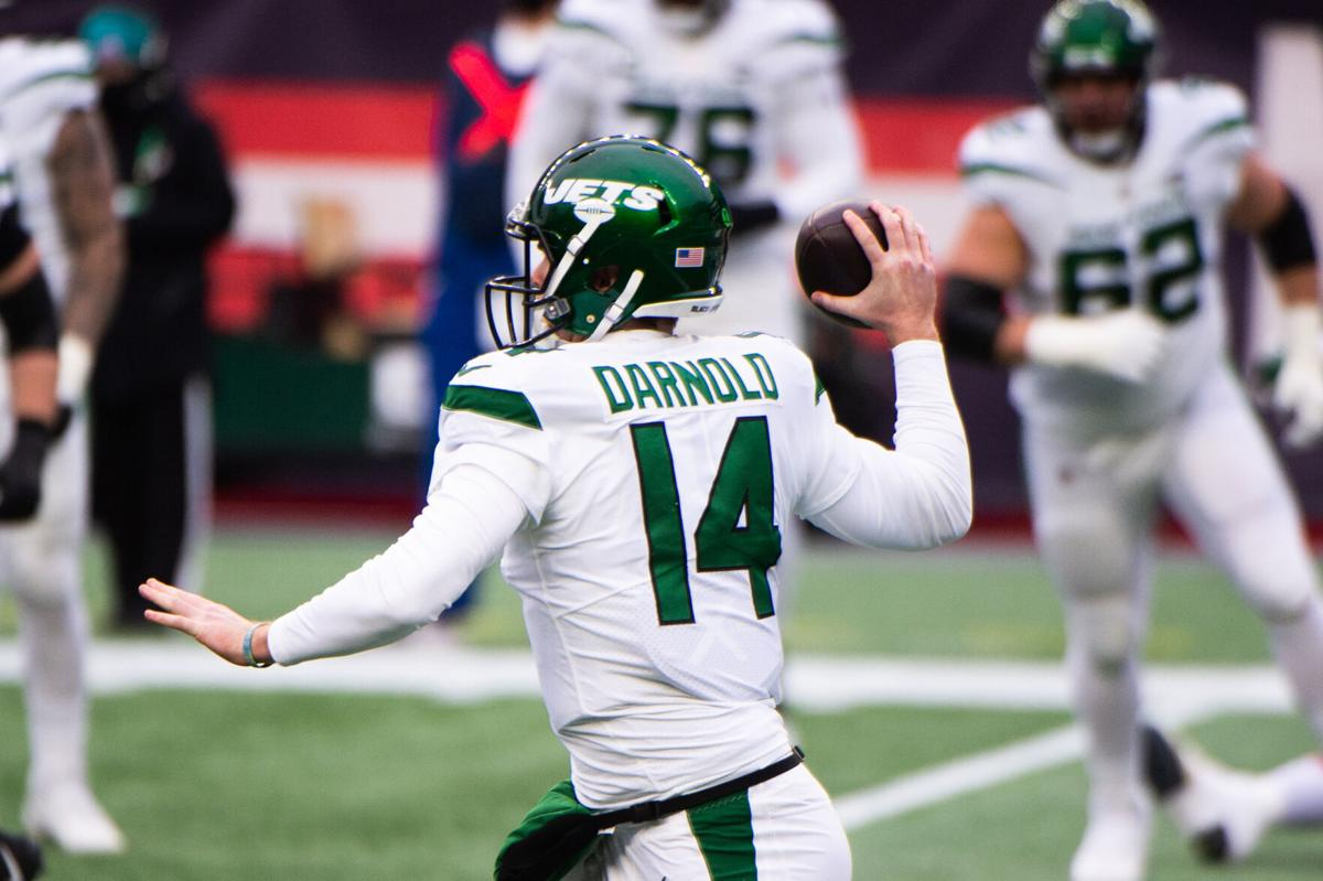 Sam Darnold of the New York Jets makes a pass against the New England Patriots in the first half on January 3, 2021 at Gillette Stadium in Foxborough, Massachusetts.