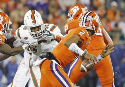 Miami linebacker Michael Pinckney (56) chases Clemson quarterback Kelly Bryant (2) in the ACC Championship Game at Bank of America Stadium on Dec. 2, 2017, in Charlotte, N.C.
