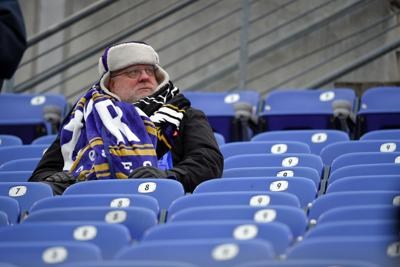 A cold Baltimore Ravens fans before a game against the Cincinnati Bengals at M&T Bank Stadium in Baltimore on Sunday, Dec. 31, 2017. The Bengals won, 31-27.