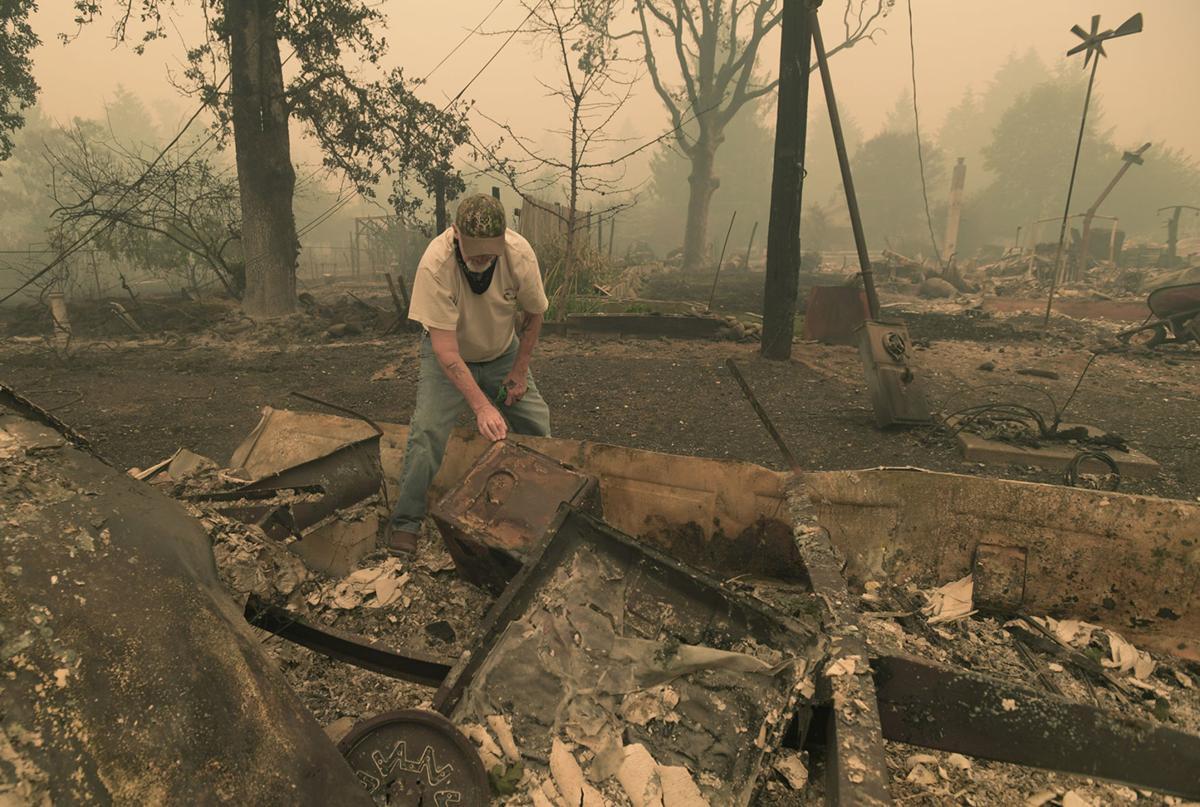 091020-adh-nws-Gates fire aftermath01-my