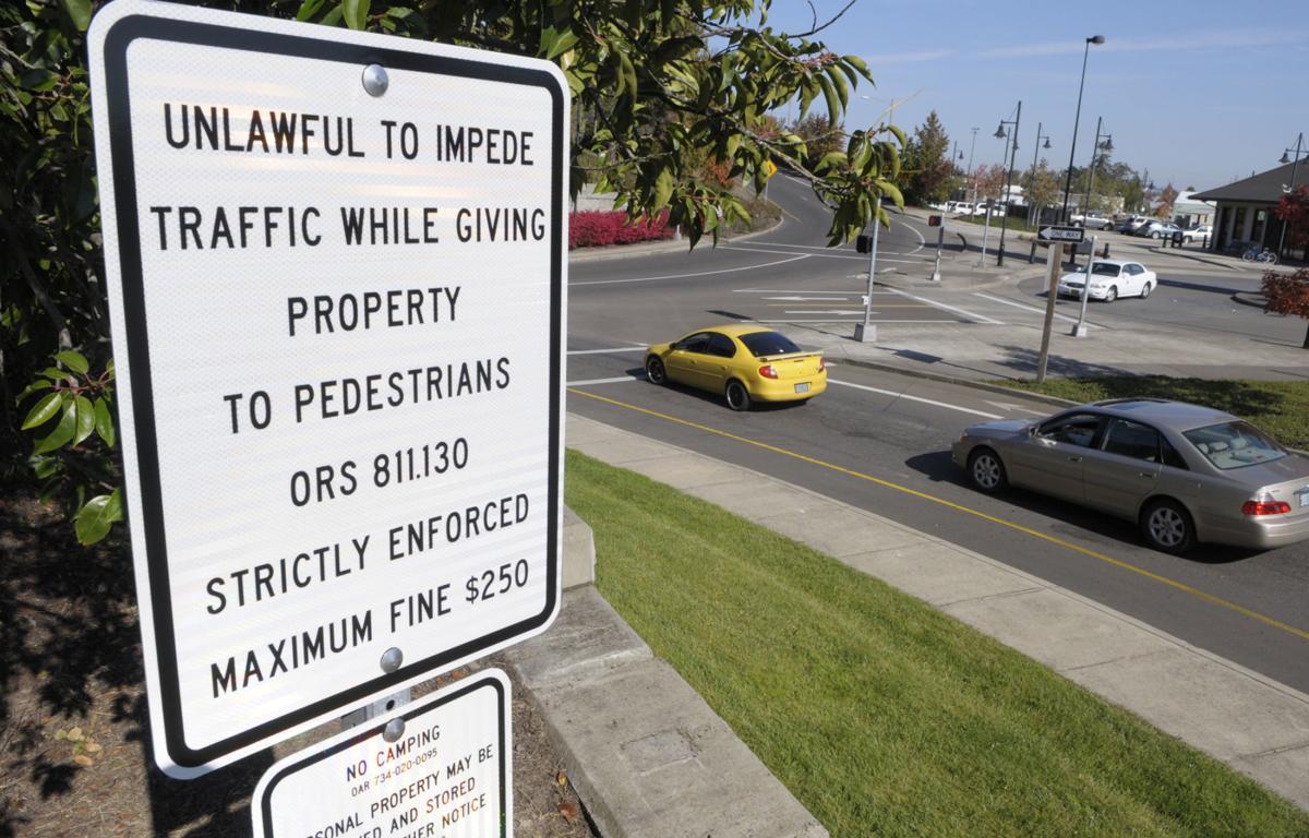 030218-adh-nws-Panhandling sign-dp