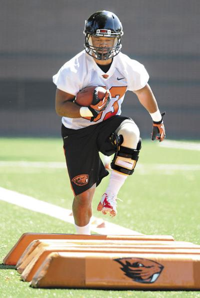 fec05c5144 Oregon State fullback Tyler Anderson is recovering from a torn ACL in his  left knee. He admits wearing a knee brace is not a lot of fun.