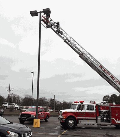 Firefighters change light bulbs