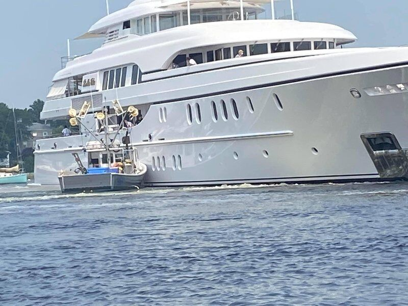 Leaving port, yacht collides with moored fishing boat