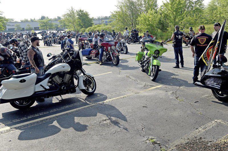 Thousands ride in memorial tribute