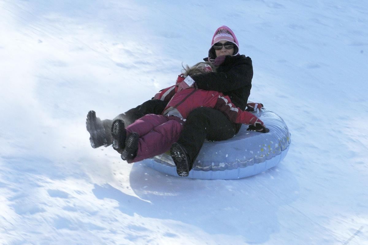 Debbie O'Sullivan of Derry and her daughter Eleanor, 5, slide down the sledding hill during the 17th annual Frost Festival activities at Alexander Carr Park.