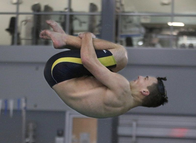 Double duty: Armstrong pitches in for Windham as swimmer and diver, becomes state champ