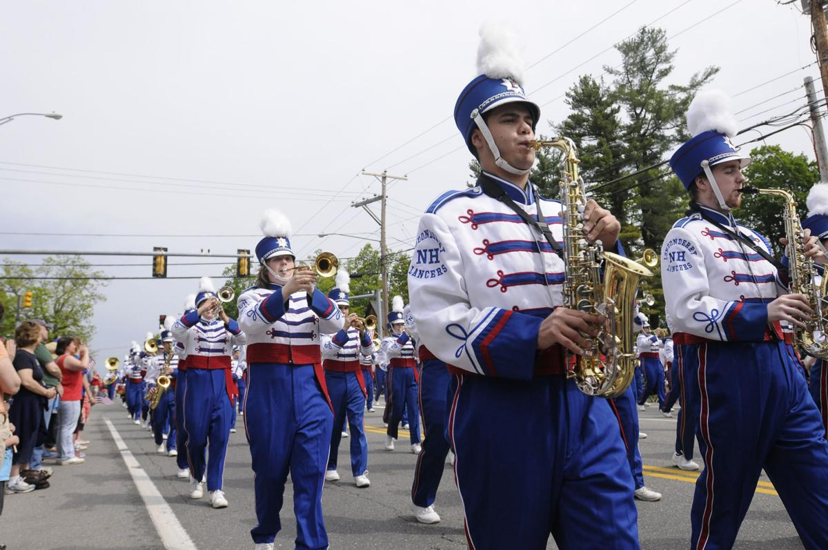 Londonderry Lancers Marching Band performs along Mammoth Road during the Memorial Day Parade.