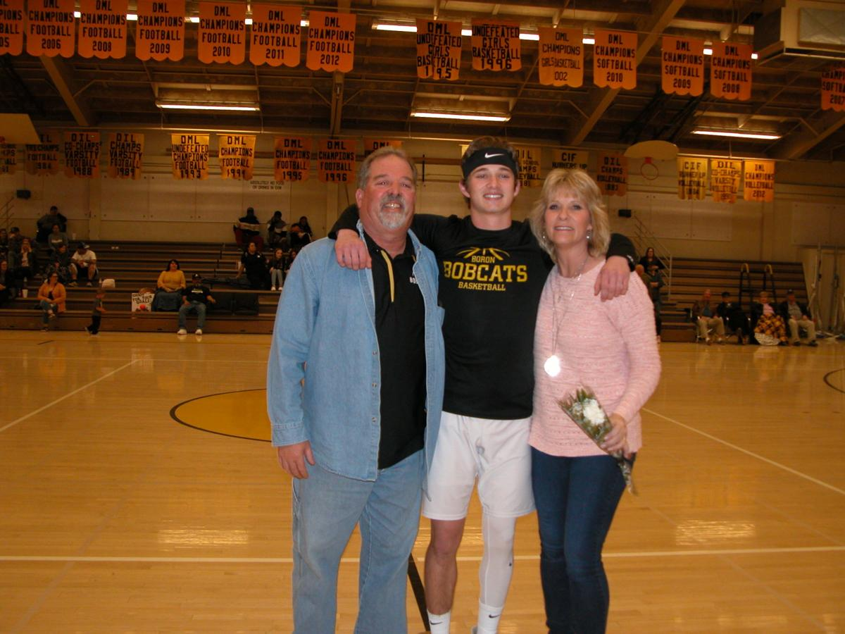 2020 Bobcat Varsity boys basketball senior Aaron Core and his mom and dad