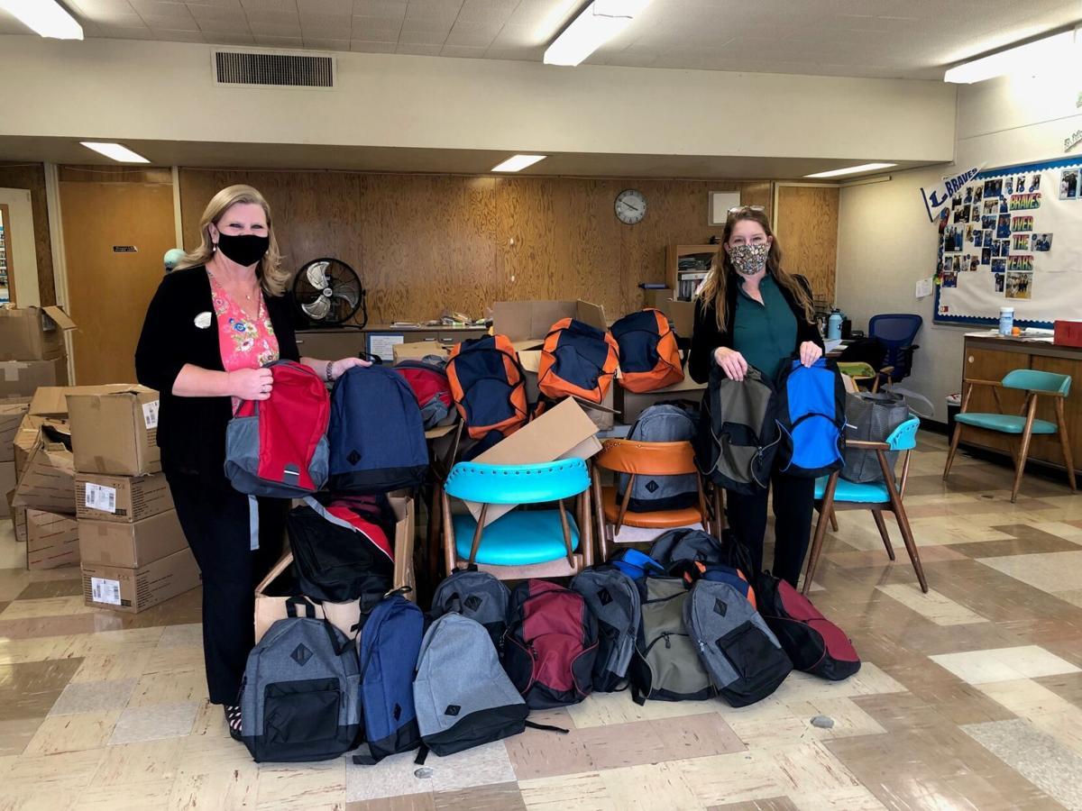 Bank of the Sierra employees prepare backpacks for local schools_1.jpg