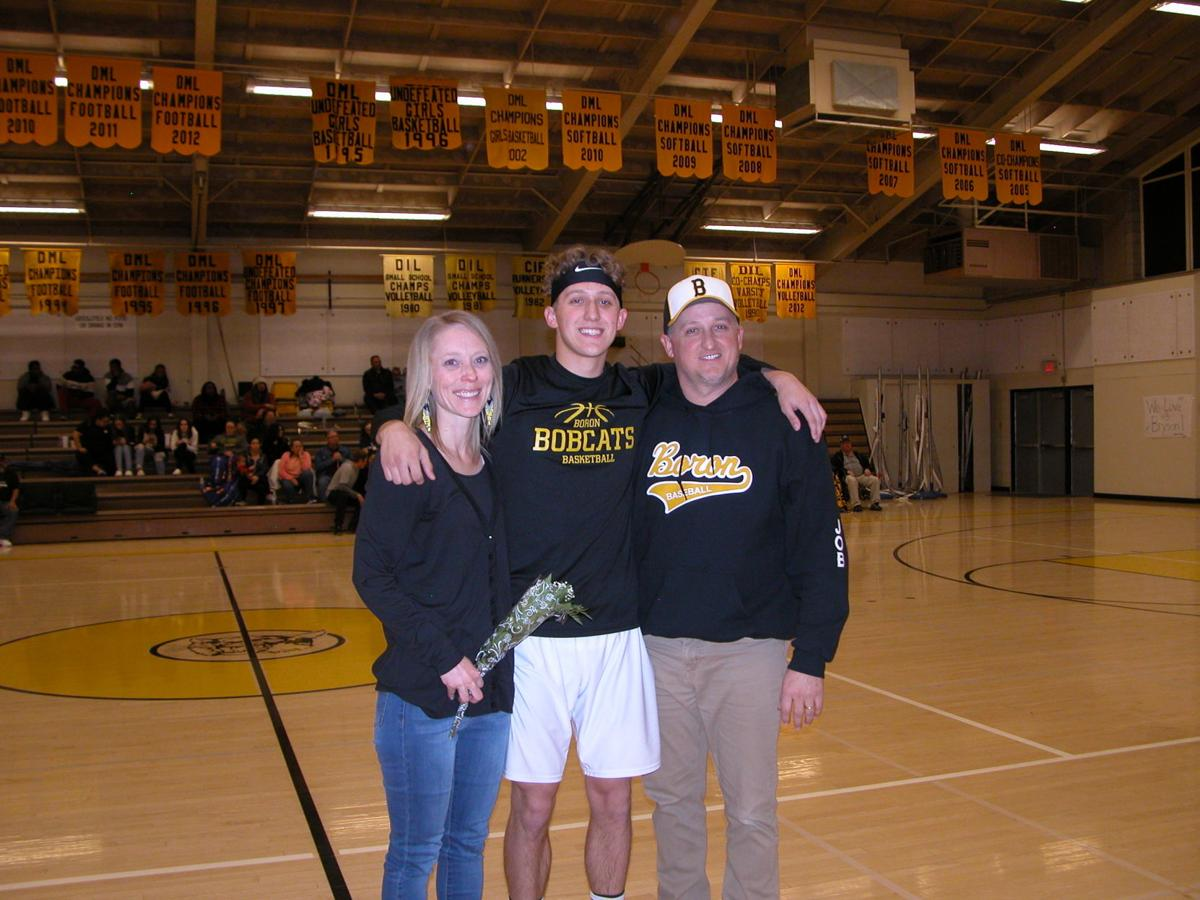 2020 Bobcat Varsity boys basketball senior Bryson Job and his mom and dad_