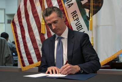 Governor Newsom signs emergency legislation to fight COVID-19.