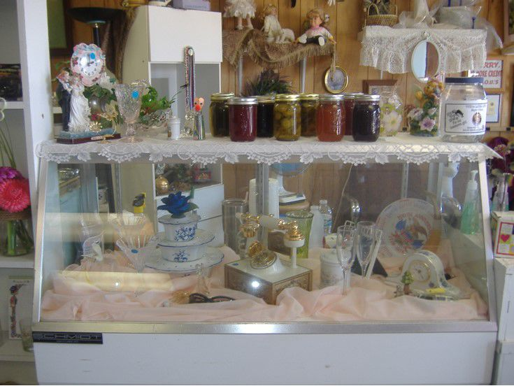 Glassware and canned fruits display inside front door of the thrift store; please ask for assistance in handling..jpg