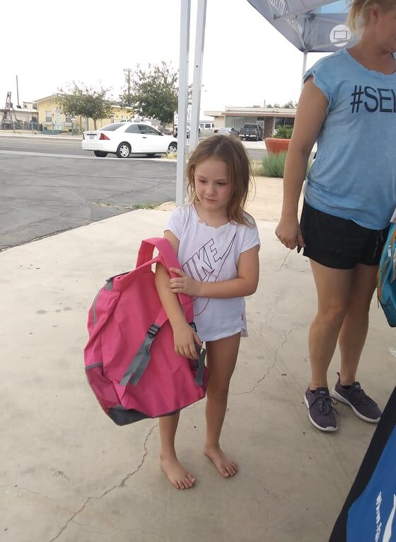 Race Communications holds Backpack Giveaway in Boron