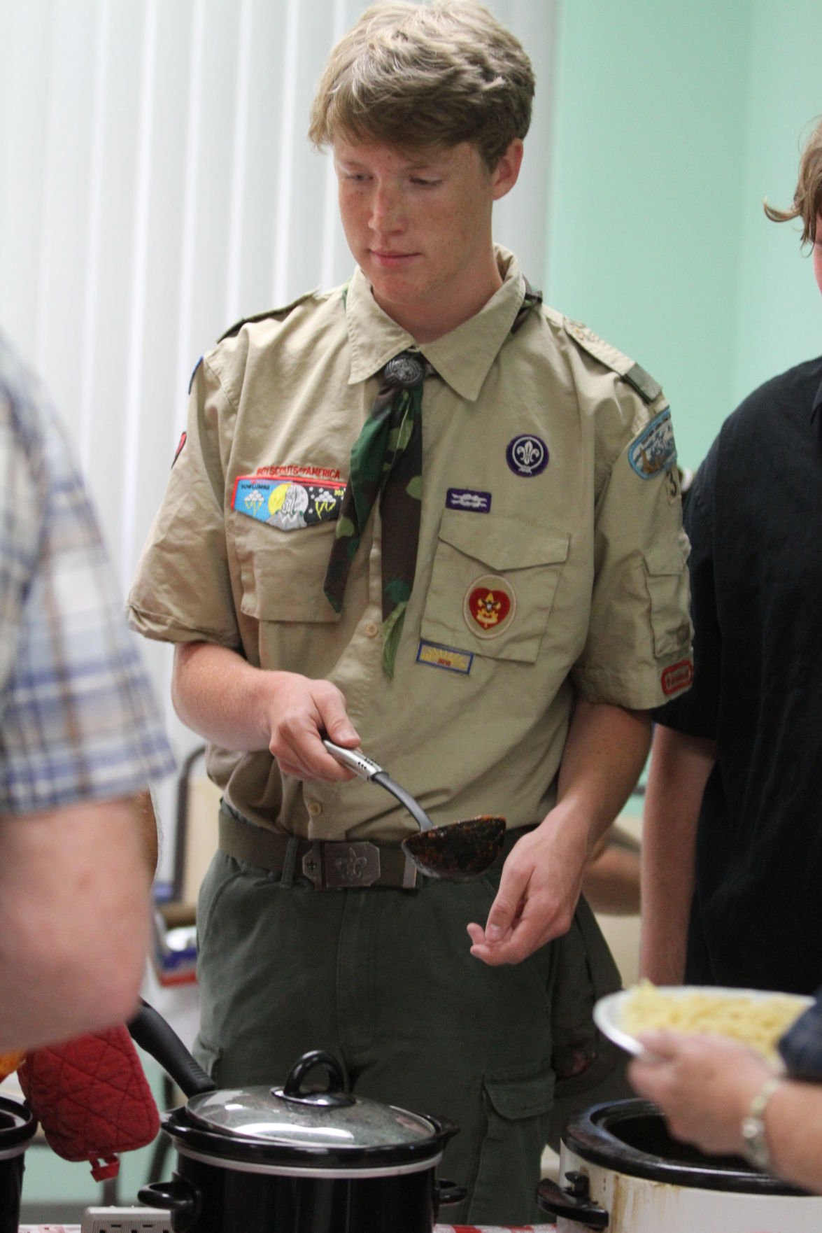 Boy Scouts Troop 3 cook Spaghetti Dinner for Cal City Seniors.