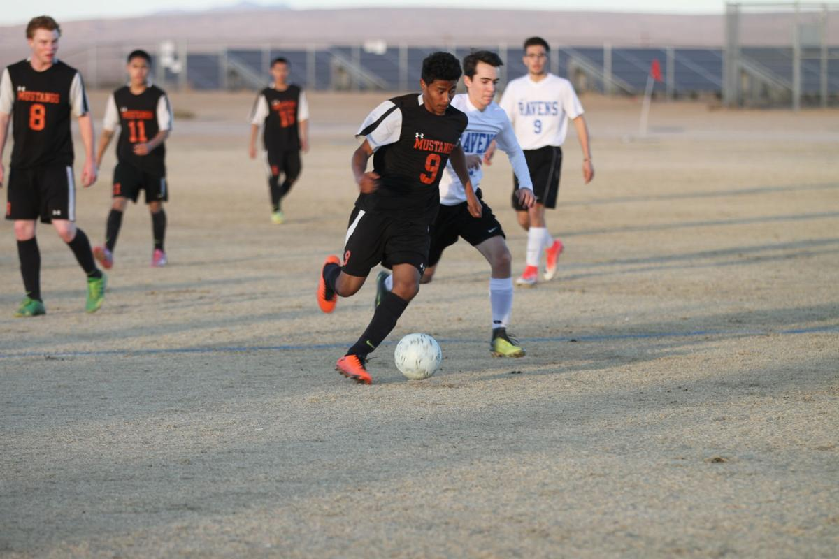 Ravens and Mustangs mix it up in 5-1 loss to McAuliffe 12-11-17