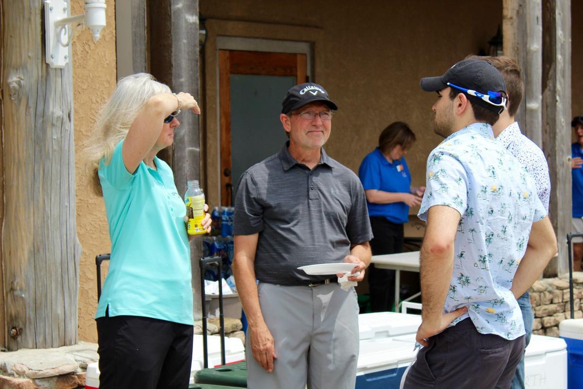 0502 Autism golf fundraiser JUMP PIC.jpg