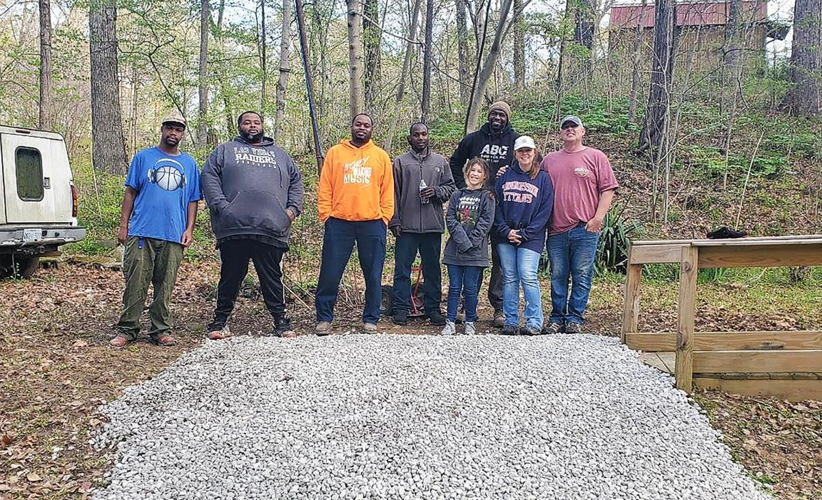 Volunteers with Restoration NOW stand behind their completed project