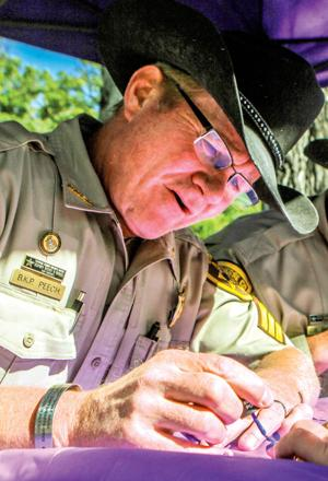 Male cops paint nails blue, purple for Polished huMan