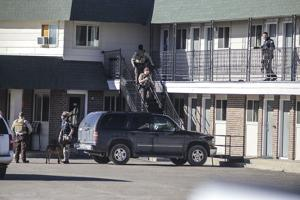 Police investigate report of motel gunman