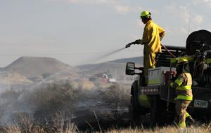 Grass fire contained to 10 acres