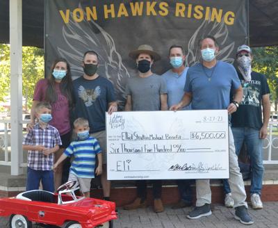 Von Hawks Rising presents $6,500 to Strutton Family