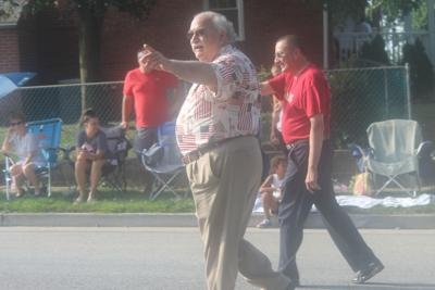 Del. Ric Metzgar (R-6) and his chief of staff Paul M. Blitz walk the 2019 Dundalk Fourth of July Parade