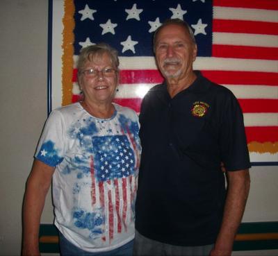 Commander John Frado and Chaplain Sharon Frado