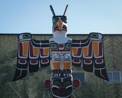FEATHER - Kwakiutl Thunderbird on a replica of a memorial totem pole in Duncan, B.C.
