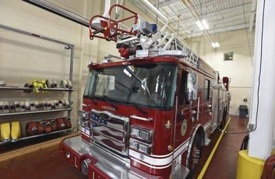 Ladder truck inspected by chief before delivery