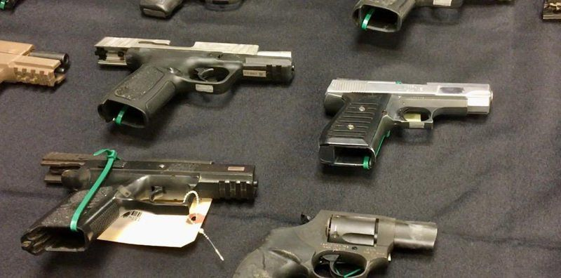 32 charged, 79 weapons seized