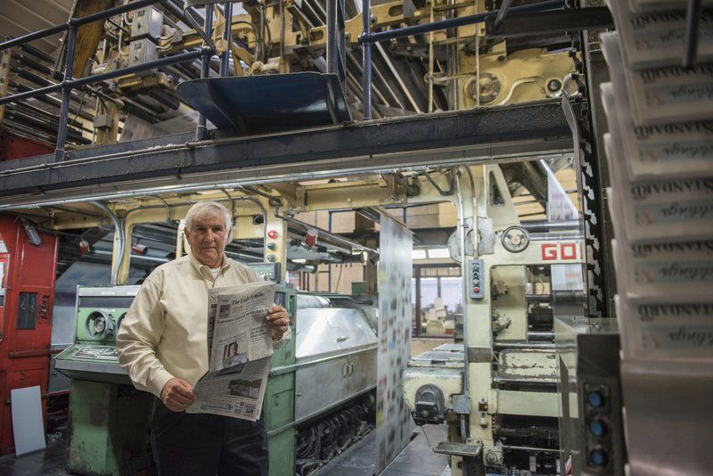 Ink-stained pressman endures