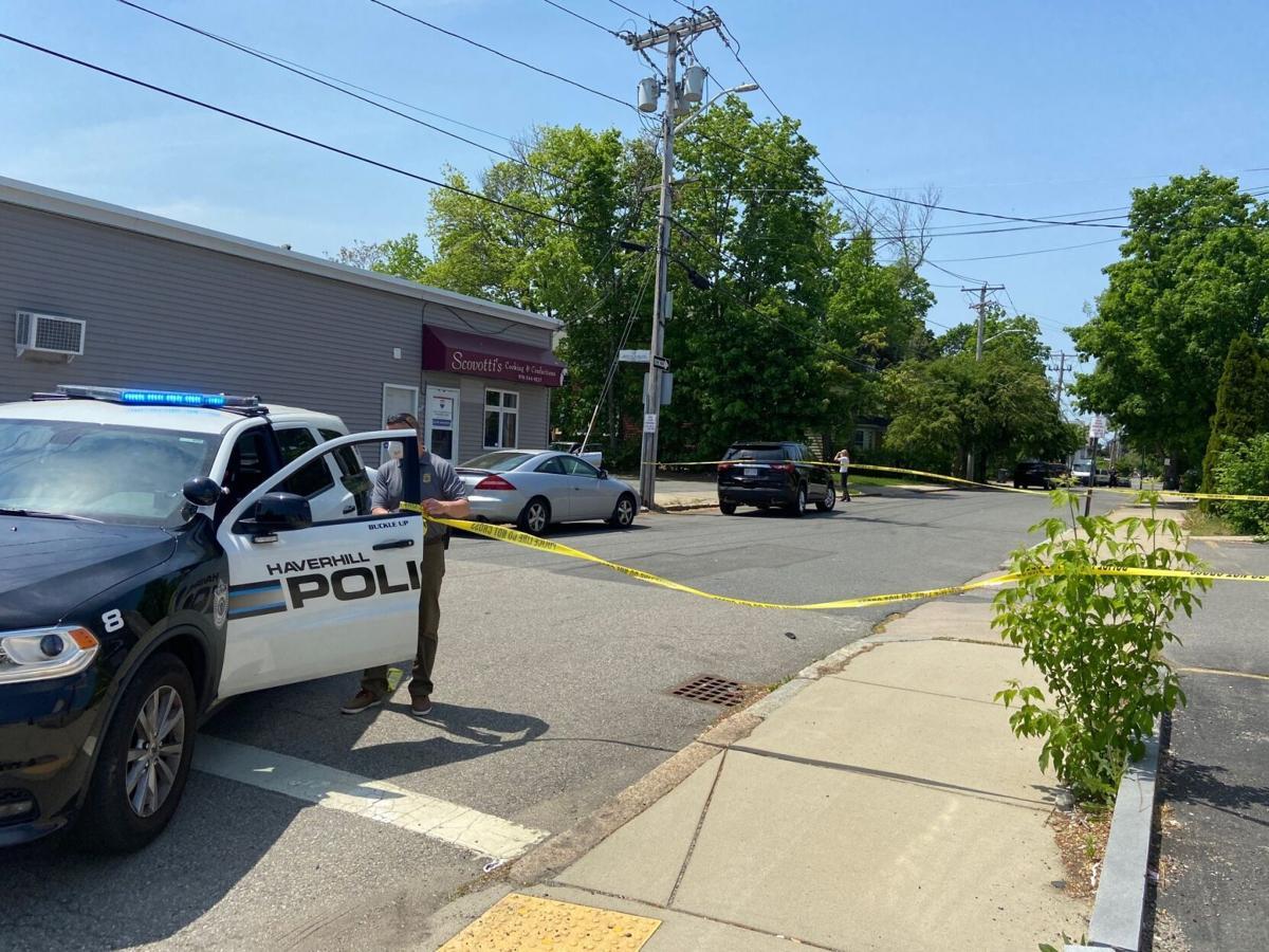 Police cruiser blocks traffic after stabbing