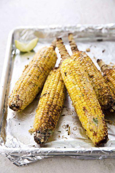 Messy, cheesy grilled corn is sure to be a hit
