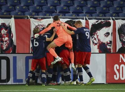 Bou's score advances Revs in MLS playoffs