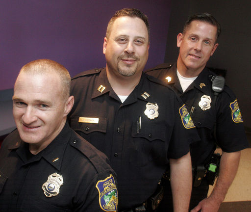 Three members of the Salem Police Department promoted yesterday are, from  left, Detective Lt. Devin Kinneen, Patrol Capt. John Lozowski and Patrol  Sgt. Mike ...